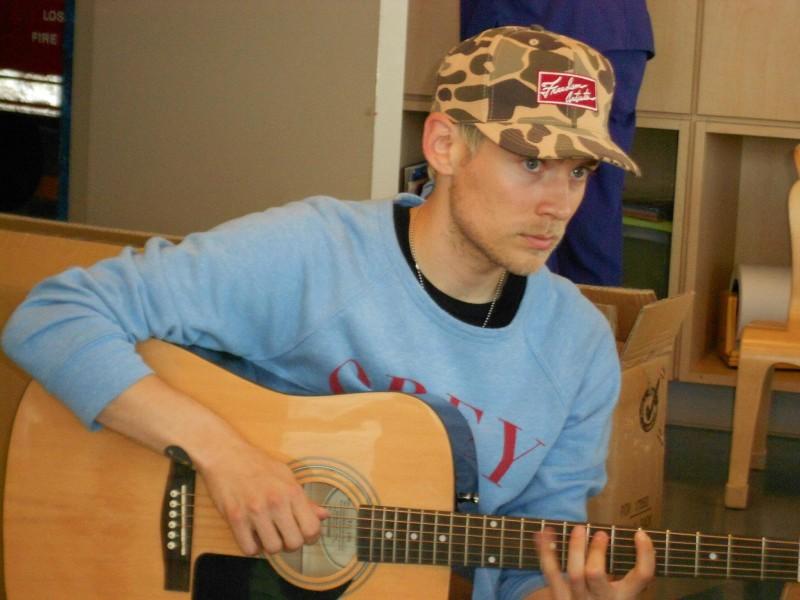 Evan giving an impromptu guitar lesson.