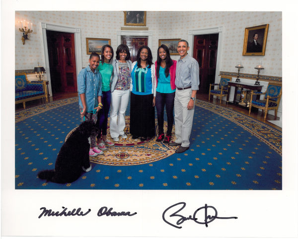 Coco Poses With the President!