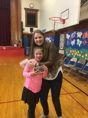 Southampton Elementary School second-grader Ana Zapata gets a hug from Lizzie Sider, who was at the school last week to talk about bullying. It was the only school on Long Island selected for the presentation. Submitted Nov 7
