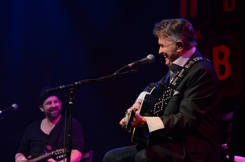 Kristian looks on as Whisperin' Bill Anderson performs