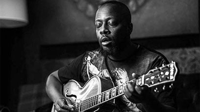 Wyclef playing a guitar better than Slash