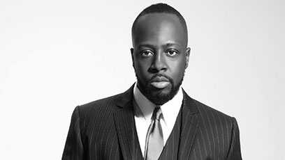 Wyclef looking professional AF in a suit